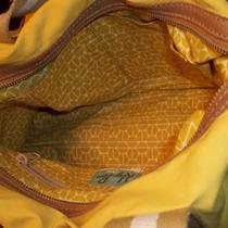 Yellow Fossil Duffel and Matching Wallet  Photo